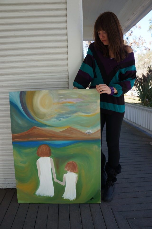 """Artist Rachael Harbert next to painting """"Hayden and Riley"""" on the porch of a Victorian house - 2"""