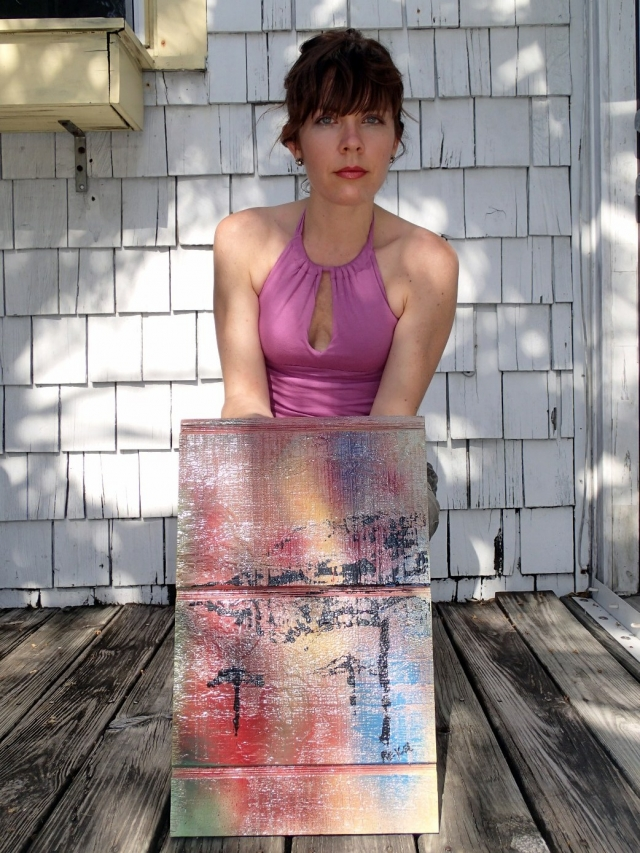 "Artist Rachael Harbert holding original version of painting ""Rainbow Sky"" in front of white house"