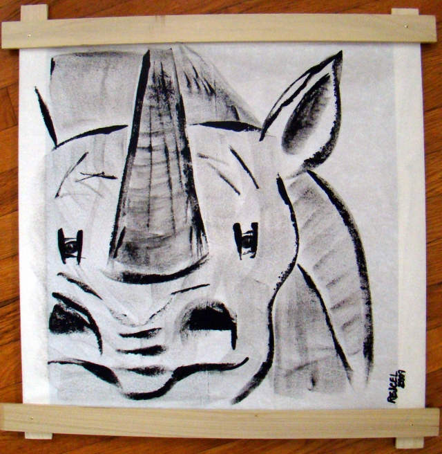 Simplistic black and white painting of the face of a rhinosceros