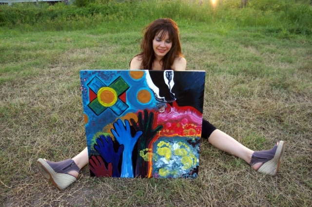 "Artist Rachael Harbert on grassy lawn with pop art painting entitled ""At the Disco"""
