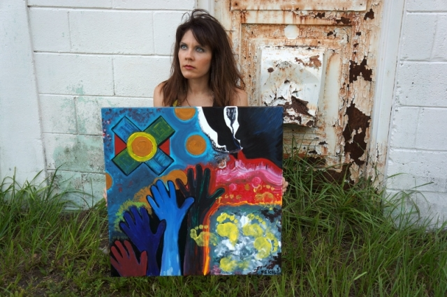 "Artist Rachael Harbert in front of rusty door with pop art painting entitled ""At the Disco"""
