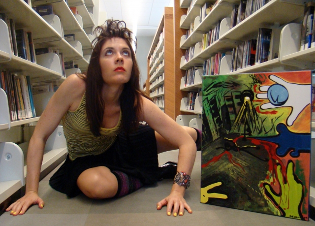 "Artist Rachael Harbert with painting ""Shadowplay"" in library"